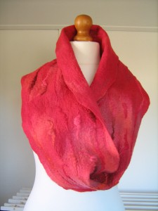Warm and cosy felted cowl in shades of bright red and orange.