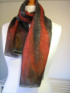 Pure silk scarf in shades of charcoal grey and flame colours