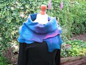 Felted cowl in blues, greens and purples.